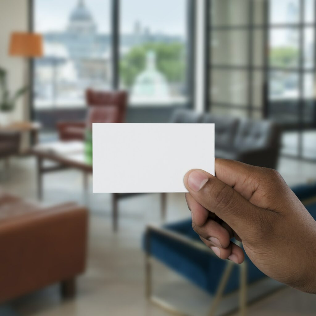 A person holding empty white business card